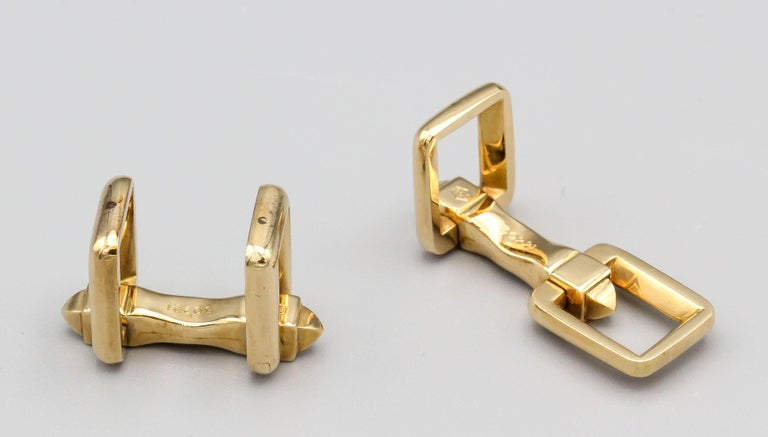 Fine pair of 18k gold folding cufflinks by Cartier, circa 1950s.  Hallmarks: Cartier, 750, reference numbers.