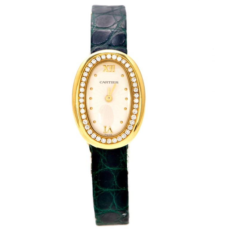 This Cartier 1990s Baignoire Diamond 18K Gold Vintage Ladies Watch is a delicate example of Cartier's designs timelessness weighing 28.5 grams  Expertly crafted in solid heavy 18k yellow gold, composed of (42) Genuine Dazzling Diamonds round-cut,