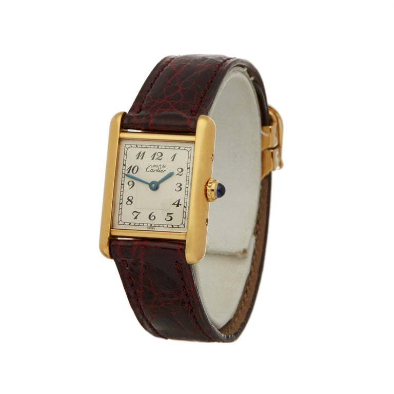 Xupes Reference: W007154 Manufacturer: Cartier Model: Must de Cartier Model Variant: Tank Model Number:  Age:  Circa 1990's Gender: Ladies Complete With: Xupes Presentation Box Dial: White Arabic Glass: Sapphire Crystal Case Size: 20.5mm By