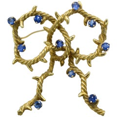 Cartier, New York 18 Karat Gold and Sapphire Bow Shaped Brooch