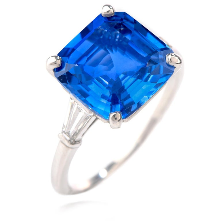 This exquisite Cartier engagment ring was inspired in a classic design and   crafted in Luxurious Platinum.    Prominently feauring a burst of color with a Natural No Heat  Sri Lankan Ceylon Asscher cut Sapphire, AGL certified 5.37 carat, measuring