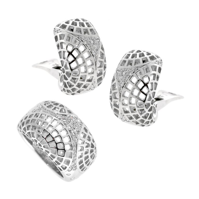 A fabulous Cartier suite from the 1990s featuring a light and airy design adorned with round brilliant cut diamonds 18k white gold.   Ring Size 6  Inventory ID: 0000544