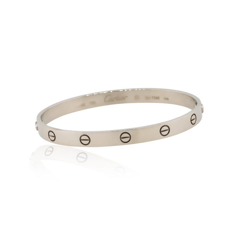 Designer: Cartier Material: 18k White Gold Bracelet Measurements: 74mm x 6mm x 64mm Cartier Size: 19 Clasp Details: Old Style Screw Weight: 40.7g (26.2dwt) Additional Details: This item comes with original Cartier box, papers and screwdriver SKU: