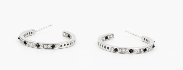 Cartier Onyx, Diamond and 18 Karat White Gold Inside Out Hoop Earrings In Good Condition For Sale In New York, NY