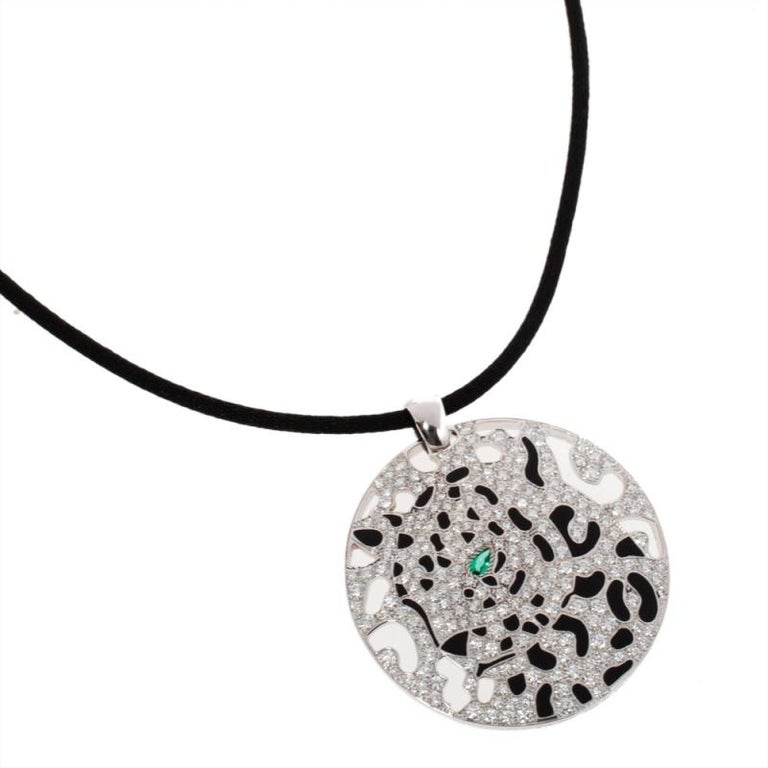 Contemporary Cartier Panther Diamond Emerald Openwork Disc Pendant Black Cord Necklace For Sale