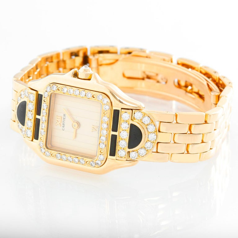 Cartier Panther Ladies 18k Yellow Gold Diamond Watch - Quartz. 18k yellow gold case with factory diamond bezel and lugs with black enamel (21mm x 30mm). Creme colored dial with raised gold Roman numeral at noon and 6 o'clock. 18k yellow gold Panther