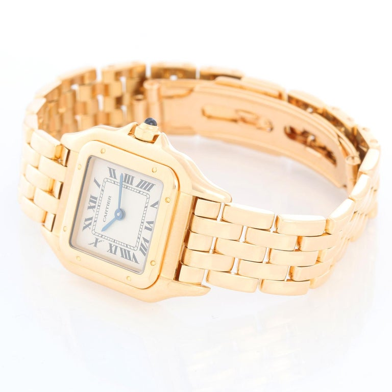 Cartier Panther Ladies 18k Yellow Gold Watch - Quartz. 18k yellow gold case (22mm x 30mm ). Ivory colored dial with black Roman numerals. 18k yellow gold Panther bracelet. Pre-owned with custom box.