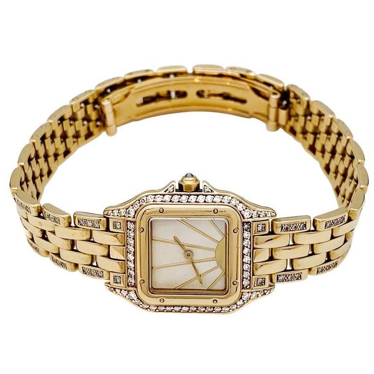 Cartier Panther Ladies 18k Yellow Gold Watch set with diamonds. 18k yellow gold case (21 mm x 30 mm) set with diamonds; Diamond crown.  Mother of Pearl Sunrise Dial.  18k yellow gold Panther bracelet partially set with single-cut diamonds. Quartz