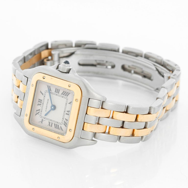 Cartier Panther Ladies 2-Tone 2-Row Steel & Gold Watch W25029B6 - Quartz. Stainless steel case with 18k yellow gold bezel (21mm x 30mm). Ivory colored dial with black Roman numerals. Stainless steel and 2-row 18k yellow gold Panthere bracelet.