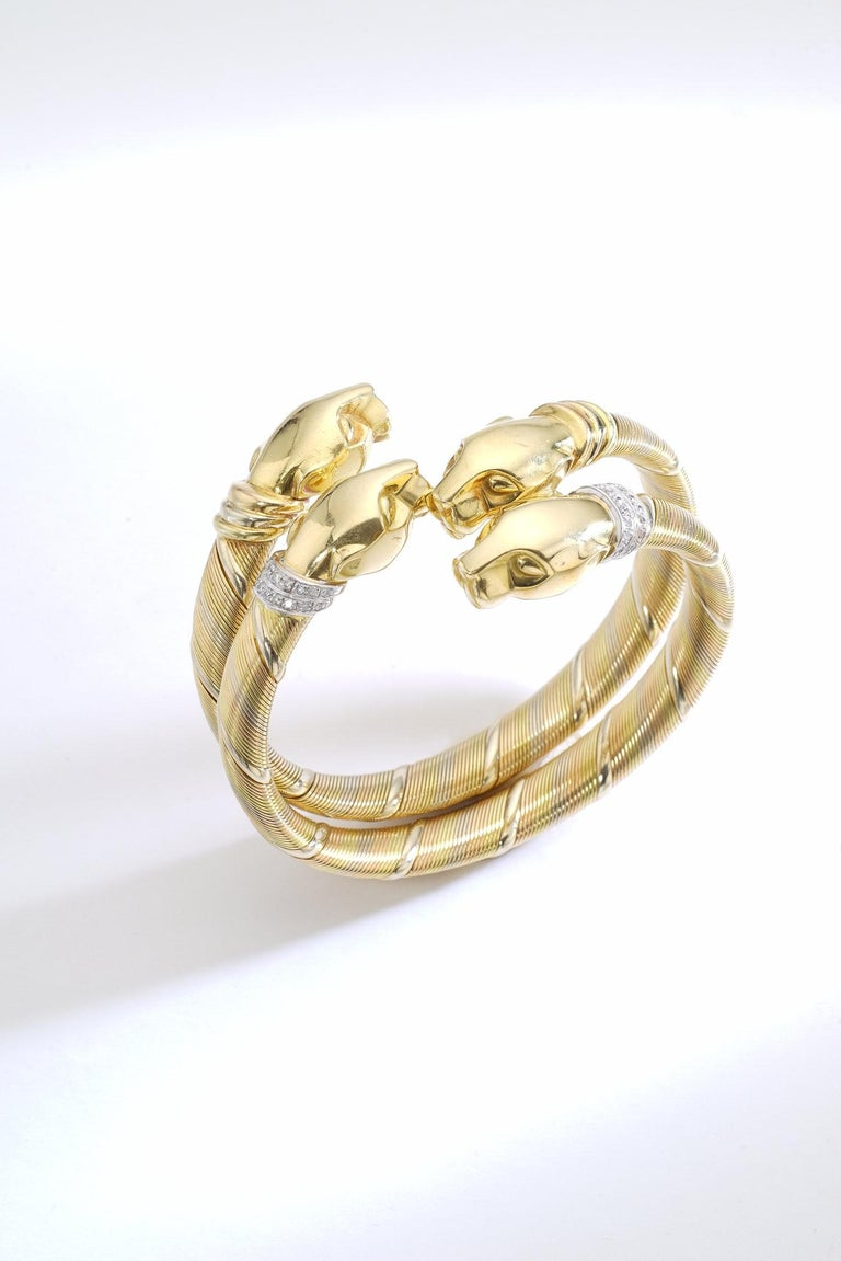 Everyone knows this emblematic Panther design from Cartier. We are so excited to present a pair wearable on the same wrist. Much better than today's ordinary Love or Juste un clou bracelets this Cartier Paris gold 18k pair of bracelets is your