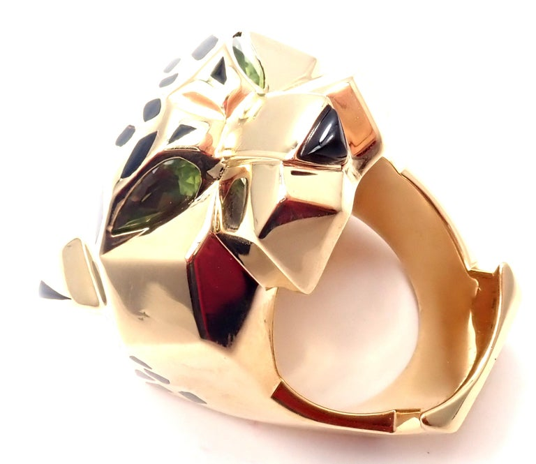 18k Yellow Gold Panther Peridot, Onyx, and Lacquer Ring by Cartier.  From Cartier's