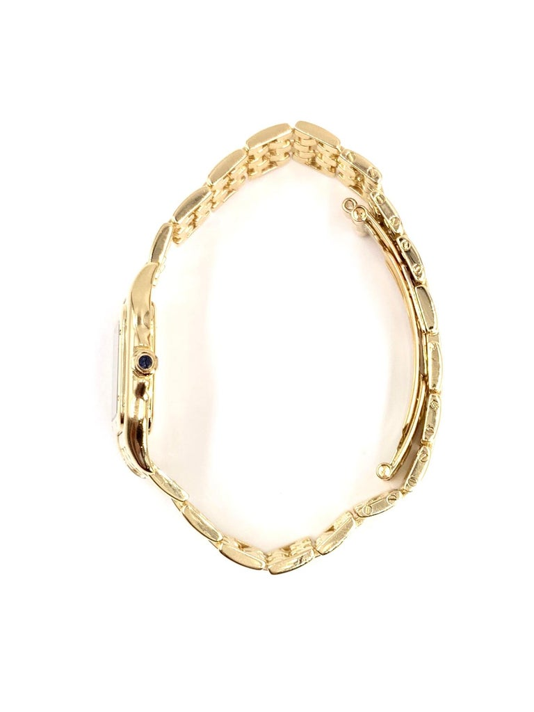 The well sought after CARTIER Panthére solid 18 karat yellow gold 22mm quartz watch, model W25022B9 (1070) in very good condition. Serial # : MG347706 Yellow gold linked bracelet with hidden butterfly clasp. Classic CARTIER off white dial with stark