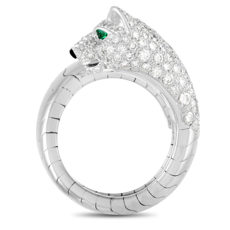 Featuring the symbolic animal of Cartier, this 18K white gold ring features an 8mm open bypass shank with a line-carved body and a diamond-studded panther head. The mythical animal accent also features emerald eyes and an onyx nose. Shimmering with