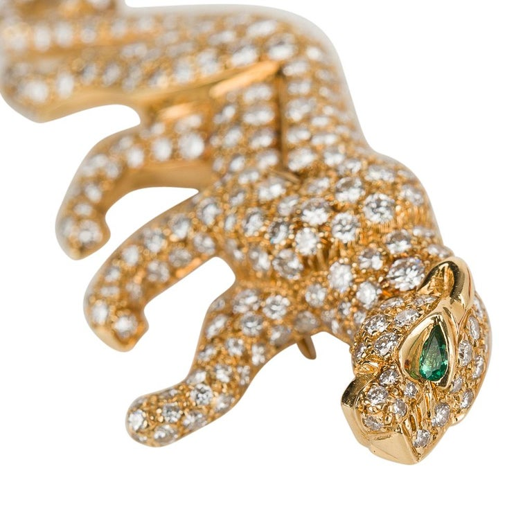 Guaranteed authentic Cartier vintage signed and numbered iconic Panther brooch features 18K yellow gold set with approximately 3.5 carats  of diamonds. The diamonds are D to E with VVS clarity. Limited edition and signed this rare brooch was created