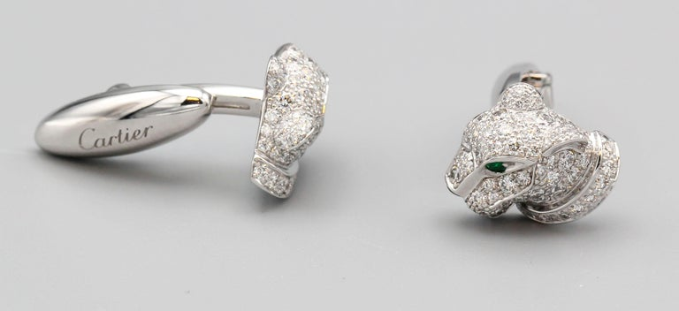 Elegant diamond, emerald, onyx and 18K white gold button cufflinks from the