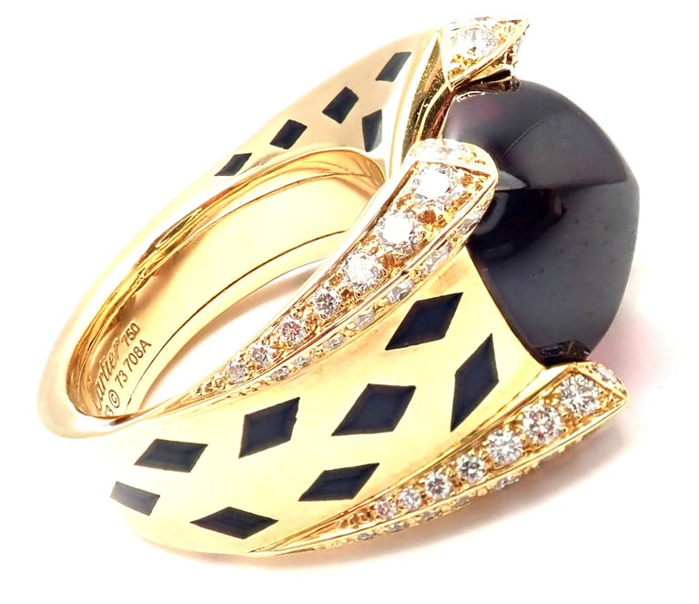 18k Yellow Gold Diamond Rhodolite Garnet and Black Lacquer Spots Panthere Ring by Cartier.  WithRound brilliant cut diamonds VVS1 clarity, E color 1 large rhodolite garnet 13.49ct This ring comes with an original Cartier certificate and Cartier