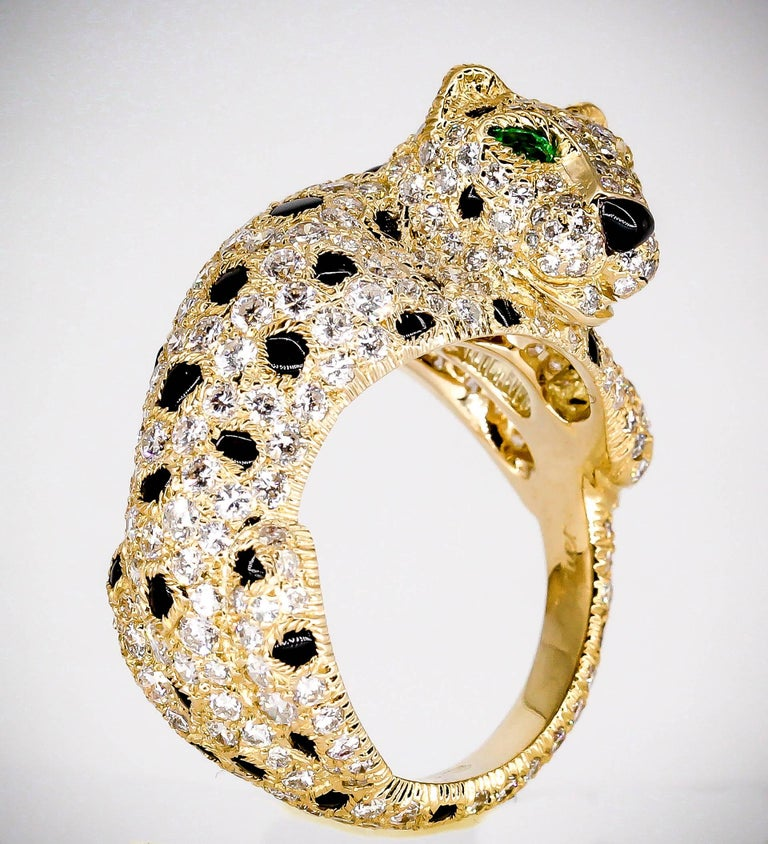 Important and rare estate 18K yellow gold, diamond, emerald and onyx ring from the