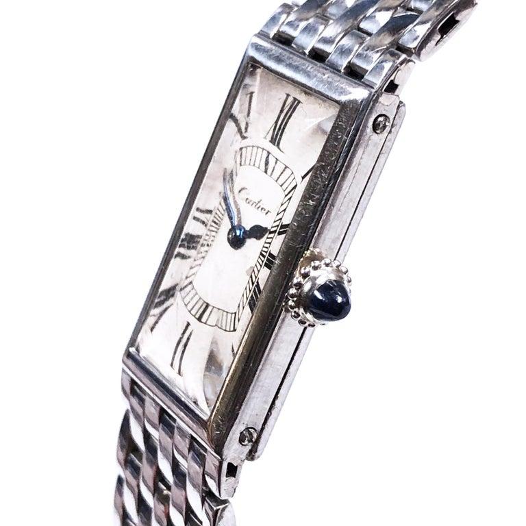 Circa 1940 Cartier Paris Platinum Bracelet Wrist watch. 24 X 15 MM 2 Piece 4 MM thick Platinum case. Mechanical, Manual wind European Watch and Clock Movement, Sapphire Crown. Original White Dial with Black Roman numerals and Blue steel hands. The