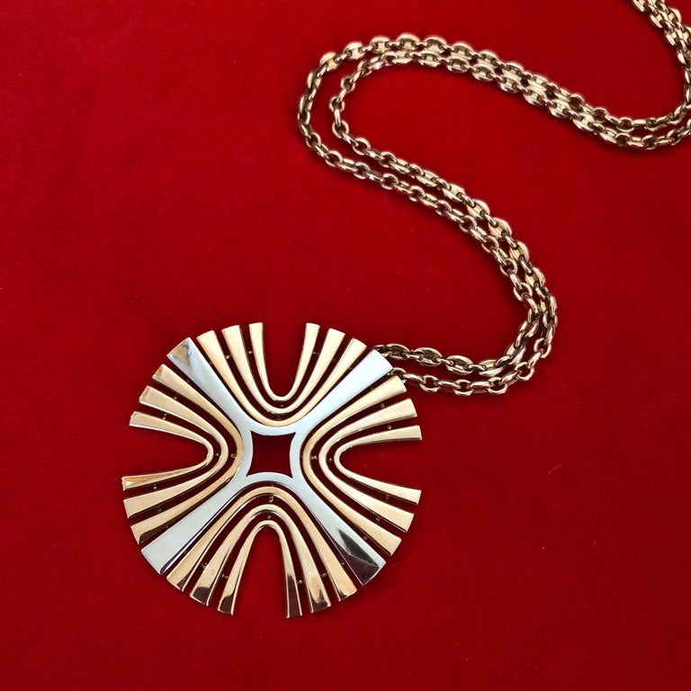An 18 karat yellow and white gold maltese cross pendant, by Cartier, Paris, 1970s  The pendant is signed Cartier, Paris and numbered 0717. It is stamped with a maker's marks, French hallmarks, and 750 and measures 2.48