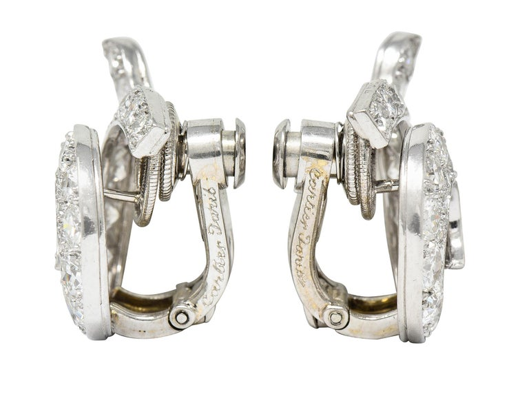 Ear-clips are designed as a spiraled swirl - dynamically formed  Bead set throughout by old European and transitional cut diamonds - graduating in size  Weighing in total approximately 5.00 carats with F to H color and VS to SI clarity  Completed by