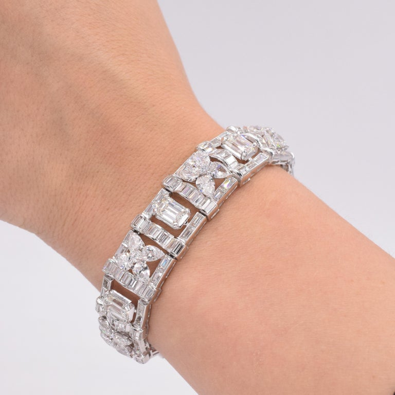 Cartier Diamond Bracelet.  This bracelet has marquise, emerald and baguette shape diamonds with a total carat weight of approximately 30carats set in platinum Measurements: 7.13 inches X 0.63 inches   Signed: Paris. Serial No. XXxxxxx