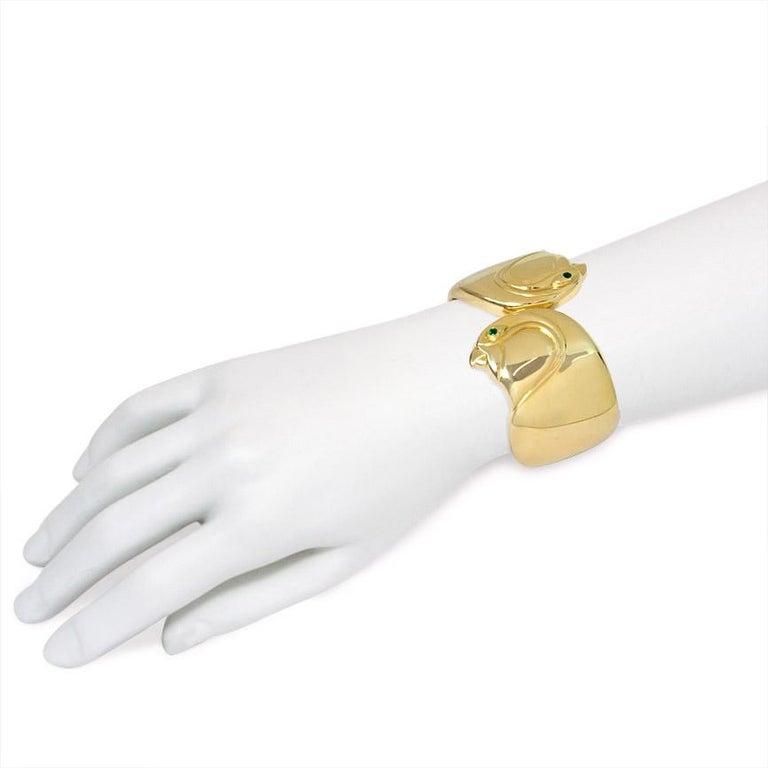 Women's or Men's Cartier, Paris Estate Gold Cuff Bracelet with Bird Head Terminals For Sale
