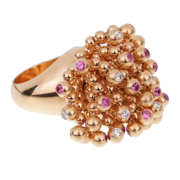 A fabulous cocktail ring by Cartier from the Paris Nouvelle Vague collection designed as bead tassels set with round brilliant cut diamonds and pink sapphires in 18k rose gold. The free flowing design of this iconic ring ensures brilliance from