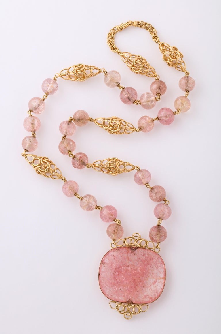 Cartier Paris Rose Quartz handmade necklace, circa 1980.  18k Yellow Gold, 126 grams.  28 inches long x 1 3/4 inches wide and 1/2 inch deep.  Hallmarks on the catch.  Materials: 18k Yellow Gold, 126 grams  Stones: Rose Quartz  Measurements: 28