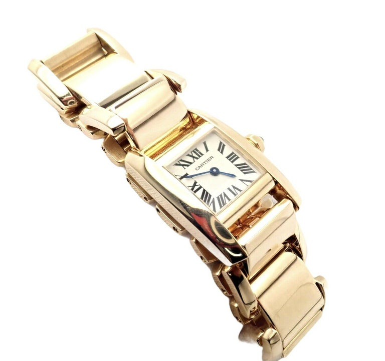 18k Yellow Gold Tankissime Lady's Wristwatch by Cartier with Quartz Movement.  Works great, fully functional. Includes Original Receipt + Cartier Booklet Certificate + Cartier Watch Box  Rare Style 2800 Details:  18k Yellow Gold Band Case with