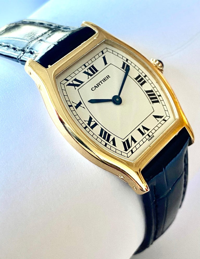 One (1) 18K. Yellow Gold Watch with a leather strap Brand: Cartier    Paris     ca 1975 Model: Tortue  extra flat   Model nr 96069   nr 45! Mouvement: Piquet nr 21 extra flat handwinding  mouvemnet nr 14613 Leather Cartier Kroko strap with original