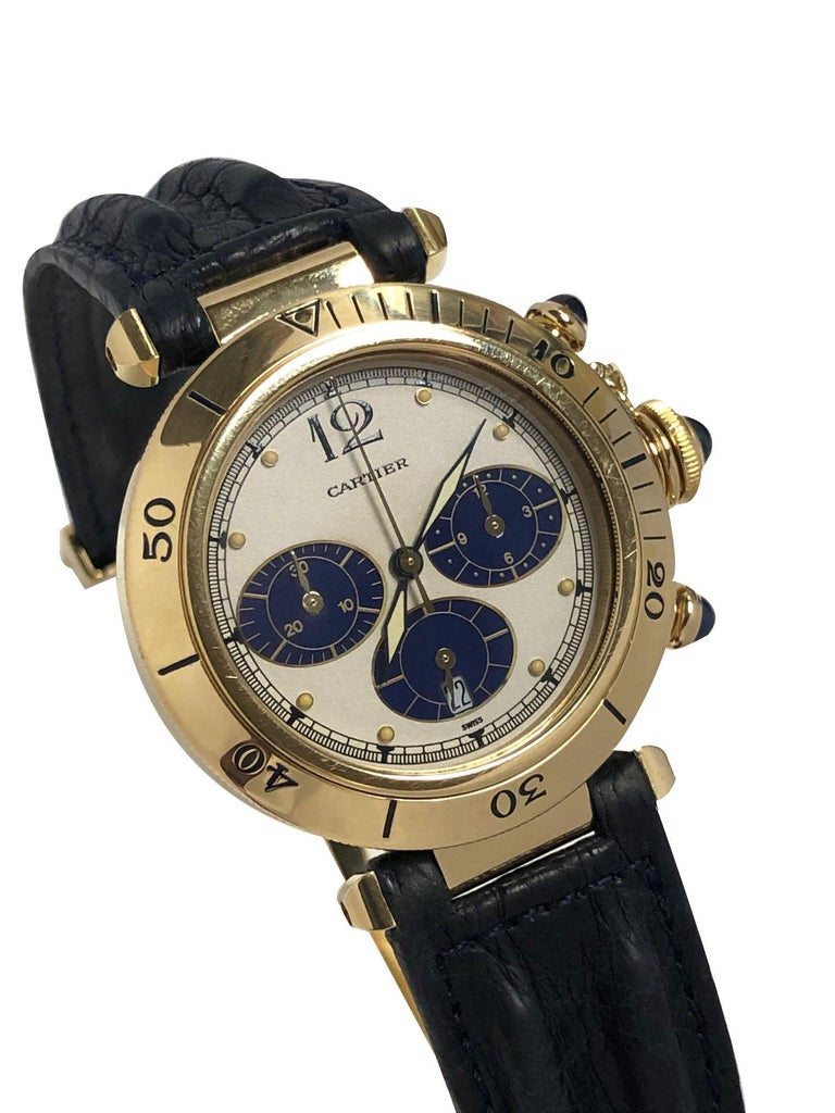 Circa 2000 Cartier, Pasha De Cartier Wrist watch, 38 M.M. 18K yellow Gold 3 piece water resistant case, quartz movement, Chronograph timing functions , water resistant lock down Sapphire crown and Sapphire Chronograph Crowns. White dial with Blue