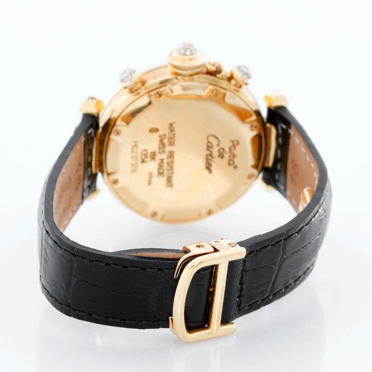 Cartier Pasha 18k Yellow Gold  & Diamond Ladies Watch on Black Strap Band - Quartz movement. 18k yellow gold  with factory diamond bezel and lugs (32mm diameter). Guilloche Ivory dial with diamond hour markers and 3 subdials . Black strap band with