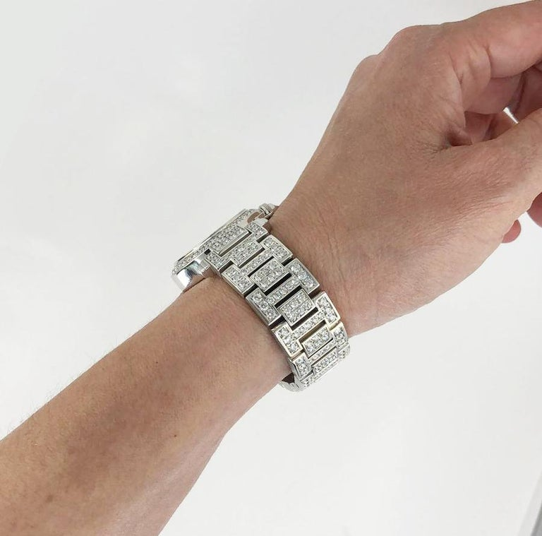 CARTIER Pasha 30mm Diamond Watch in 18k White Gold.  A classic Pasha® de Cartier watch featuring a luminescent face surrounded by a bezel of one row of white diamond pave mounted in 18k white gold. Watch strap doubles as a bracelet, with links of