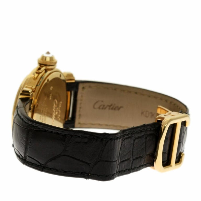 Cartier Pasha Reference #:WJ11891G. Cartier WJ11891G Pasha 32mm Ladies Watch. Solid 18kt Yellow gold case, Includes Crocodile and fabric strap, Silver dial set with 8 diamond hour markers and Arabic numerals, Blue hands, Screw down crown cover set