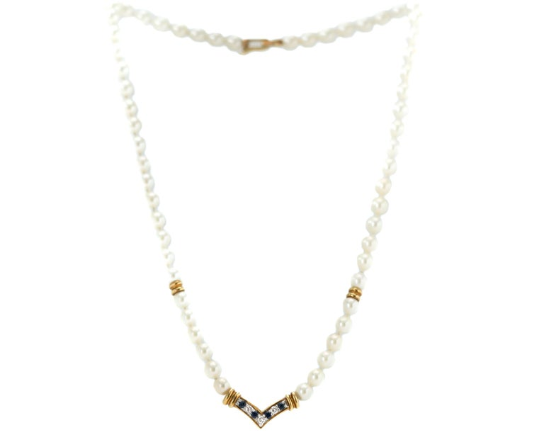 Modern Cartier Pearl Necklace with Sapphires, Diamonds and 18 Karat Yellow Gold For Sale