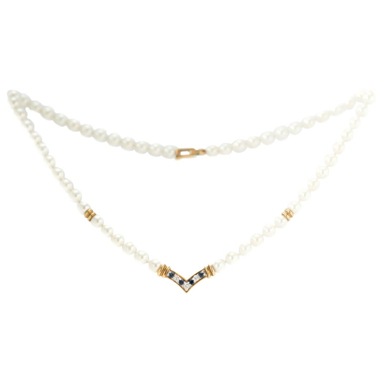 Cartier Pearl Necklace with Sapphires, Diamonds and 18 Karat Yellow Gold For Sale