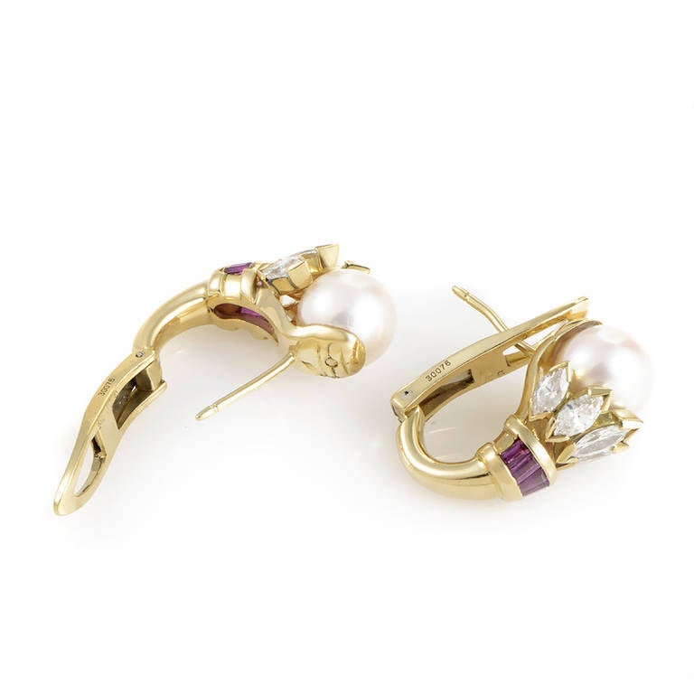 The enduring quality of this glamorous pair of earrings from Cartier is without comparison. The earrings are made of 18K yellow gold and are each set with a single white pearl. Lastly, marquise-cut diamonds and baguette-cut rubies.