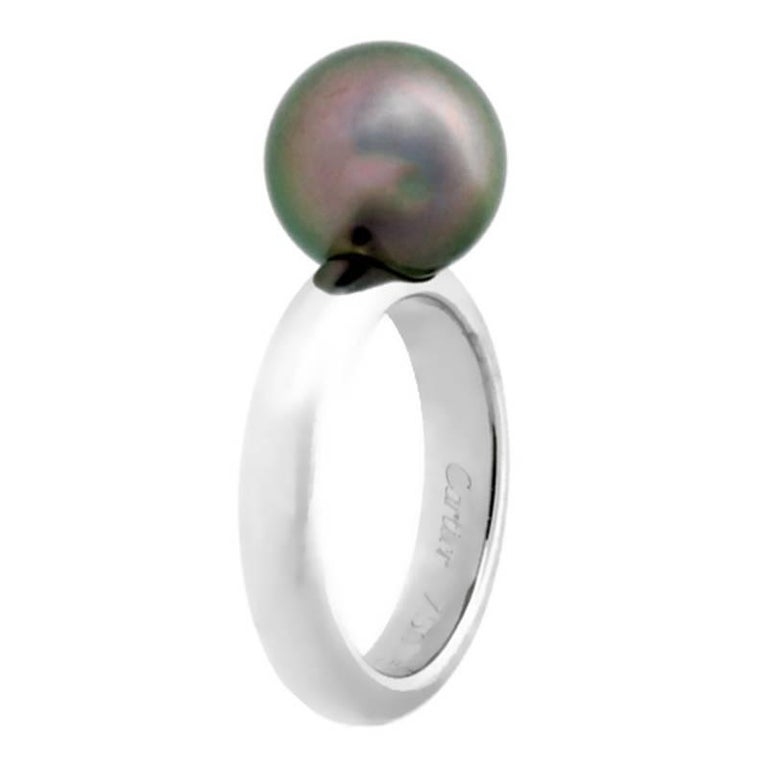 A chic authentic Cartier ring crafted in 18k white gold ring affixed with a 10mm Pearl at its crown.  Size: US 5 1/2 / EU 51 (Resizeable) Dimensions: The band measures 4mm Wide (.15″ Inches)  Inventory ID: 0000139