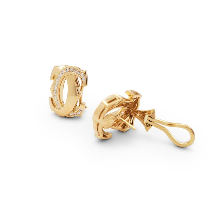 Women's or Men's Cartier 'Penelope' Double-C Yellow Gold and Diamond Earrings For Sale