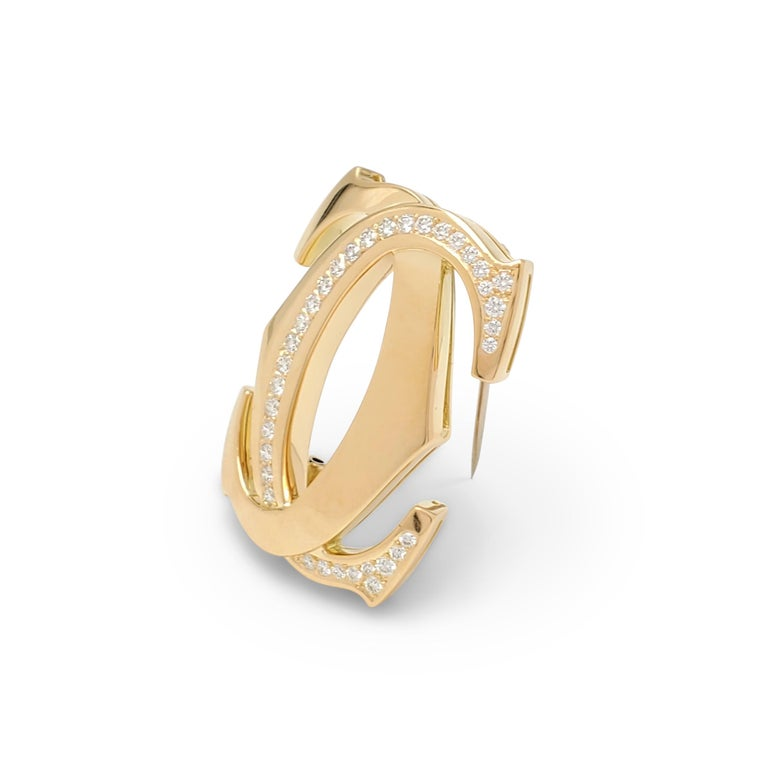 Round Cut Cartier 'Penelope' Double-C Yellow Gold and Diamond Pin For Sale