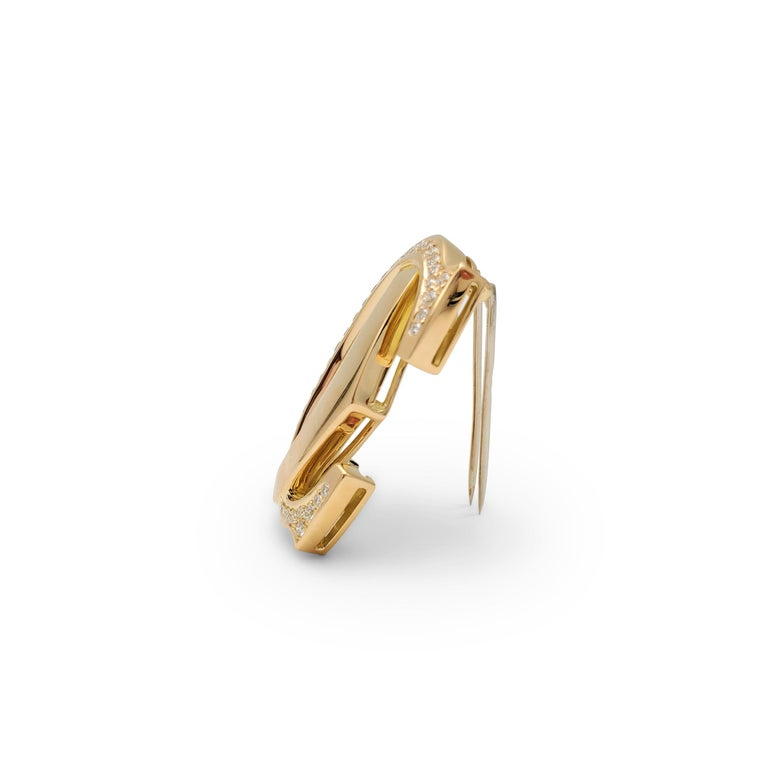 Cartier 'Penelope' Double-C Yellow Gold and Diamond Pin In Excellent Condition For Sale In New York, NY