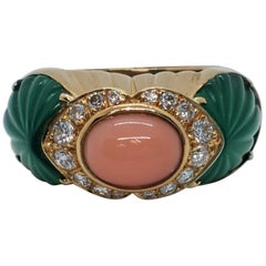 Cartier Pink Coral Oval Cabochon and Carved Chalcedony Ring in 18 Karat Gold