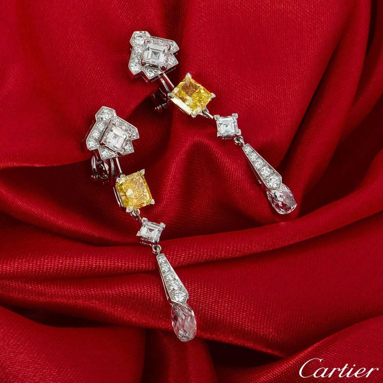 Retailing for £250,000 in 2012, we present a magnificent pair of platinum diamond drop earrings from the Mousseline collection by Cartier. Each earring features a mixture of square emerald cut, round brilliant cut and briolette cut white diamonds.