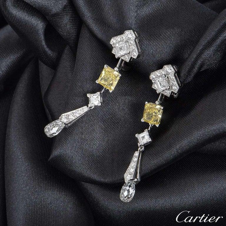 Emerald Cut Cartier Platinum Mousseline Fancy Vivid Yellow Radiant Cut Diamond Drop Earrings For Sale