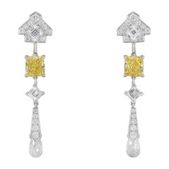 Cartier Platinum Mousseline Fancy Vivid Yellow Radiant Cut Diamond Earrings