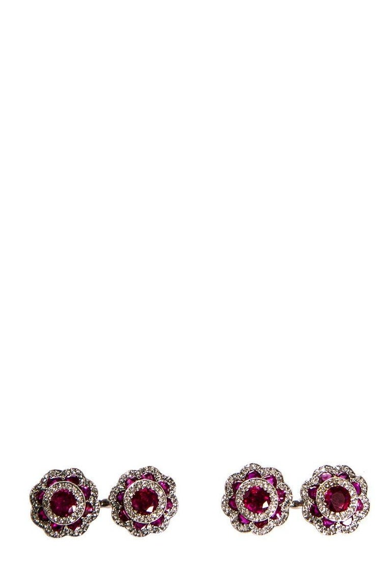 Cartier platinum ruby and diamond cufflinks. Rubies, approximately 3.40 total carat weight (center stone, approximately 2.0 carat weight and surrounding rubies, approximately 1.40 carat weight).   This item is previously worn with no visible signs