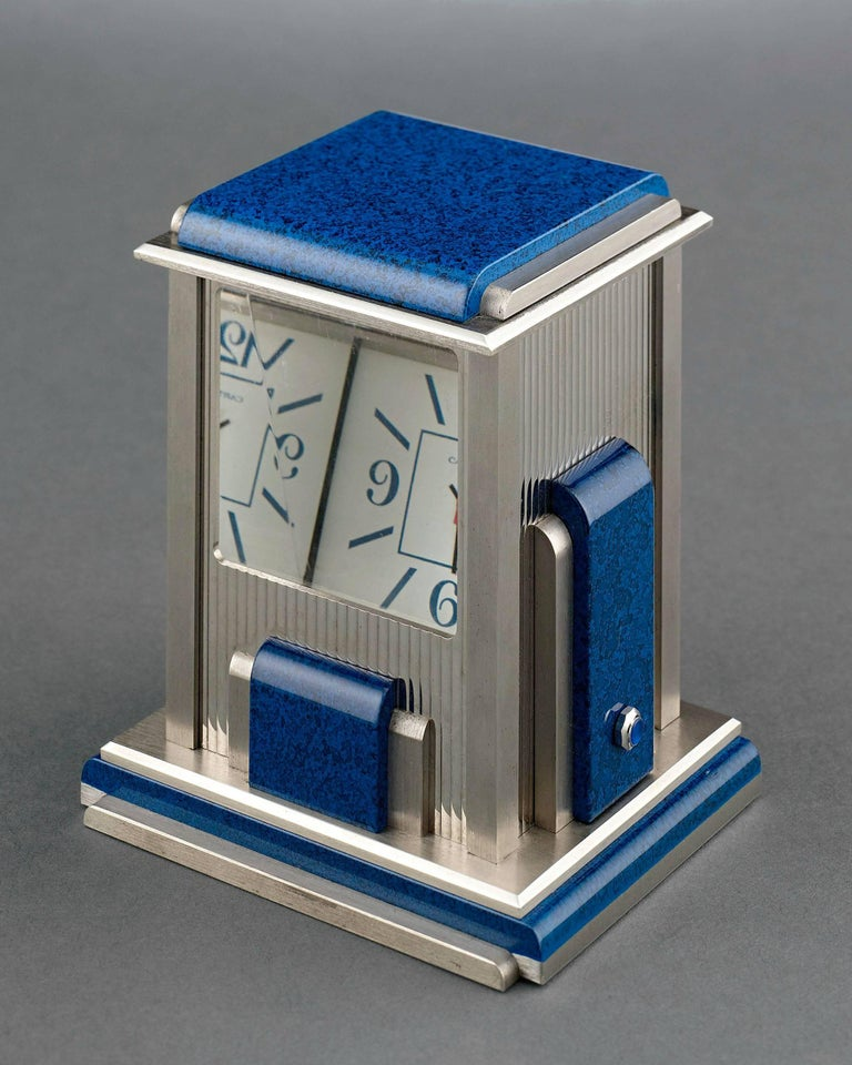 """This mystery clock by Cartier, known as a """"prism"""" clock, is a work of exceptional engineering and stylish artistry. Crafted in a sleek Art Deco style with lapis lazuli accents, this prism clock is silver-plated and fitted with quartz crystal prisms"""