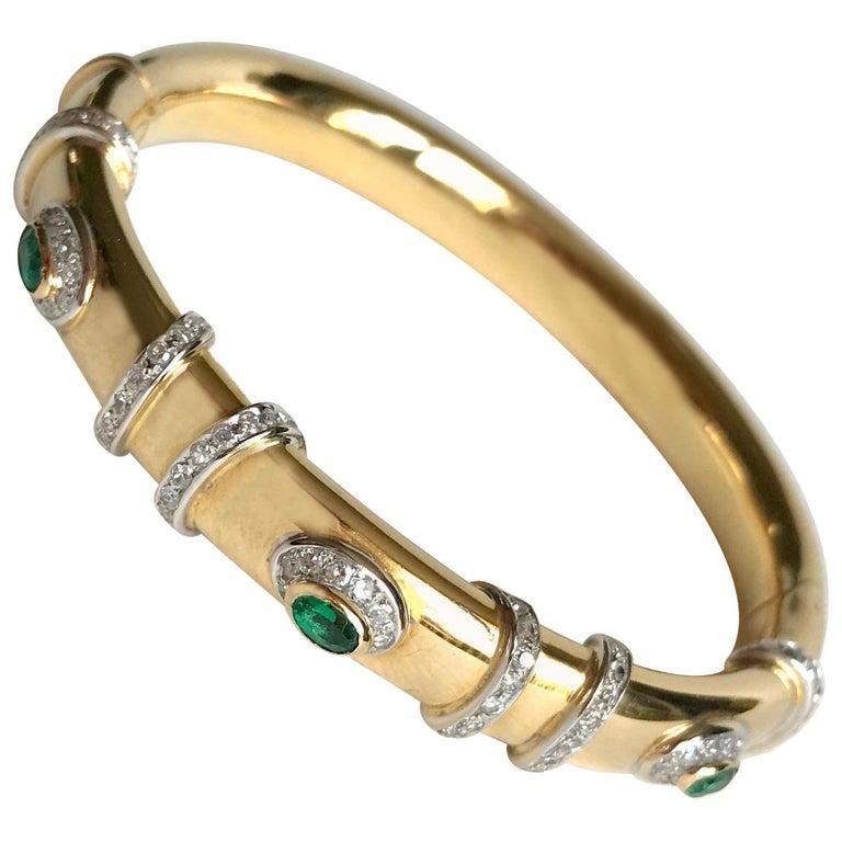 Cartier Rigid Emerald Bracelet  in Gold 18 Carat and Diamonds For Sale