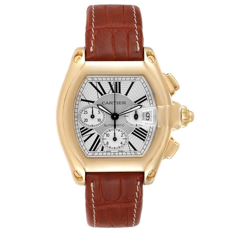 Cartier Roadster Brown Strap Yellow Gold Chronograph Mens Watch W62021Y3. Automatic self-winding movement with chronograph function. 18K yellow gold tonneau shaped case 47 x 43 mm. Scratch resistant sapphire crystal with cyclops magnifying glass.