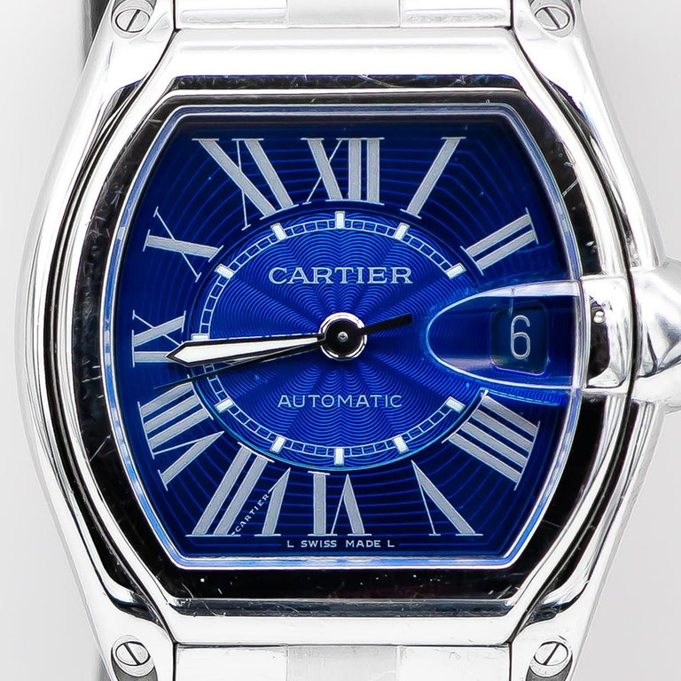 Brand: Cartier  Movement: Self-Winding Automatic Movement, Swiss Made  Case Dimensions: 43 mm x 38 mm  Water-Resistant Up To 100 Meters/330 Feet  Dial: Blue Dial With Roman Numerals  Metal: Stainless Steel  Condition: Good (Previously Owned)